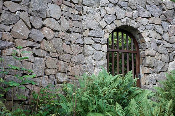 Gate in Rock Wall stock photo