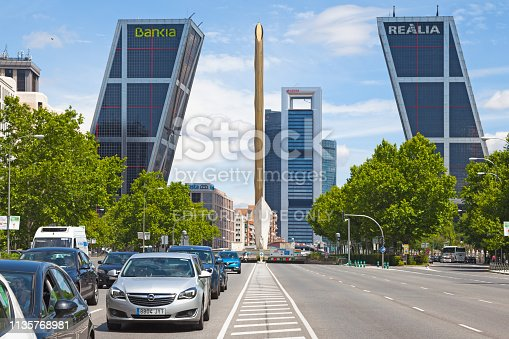 Madrid, Spain - June 07 2018: Monument to José Calvo Sotelo and the Caja Madrid Obelisk on the Plaza de Castilla with the Twin skyscrapers of the Puerta de Europa and the skyscrapers of the Cuatro Torres Business Area.
