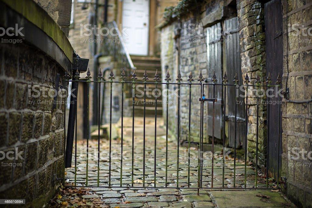 Gate on Stone Pathway stock photo