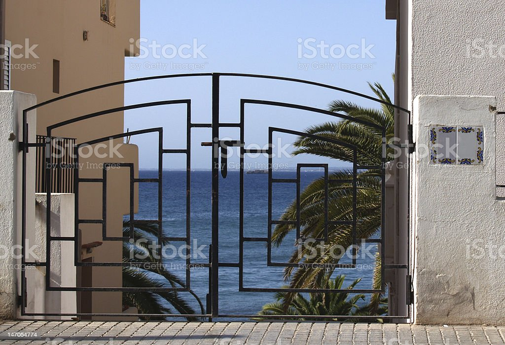 Gate overlooking Ocean royalty-free stock photo