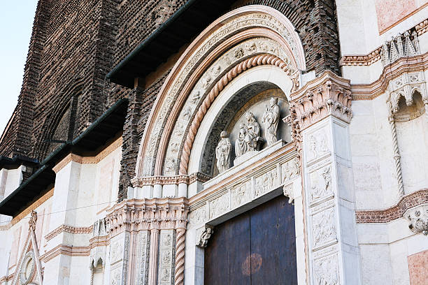 gate to Basilica of San Petronio in Bologna travel to Italy - gate (The Porta Magna with sculpture by Jacopo della Quercia) to Basilica of San Petronio in Bologna city porta magna stock pictures, royalty-free photos & images