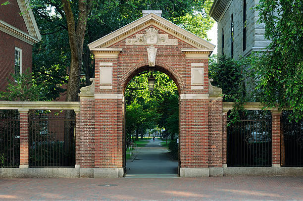 Gate to Harvard Classic gate to Harvard Yard harvard university stock pictures, royalty-free photos & images