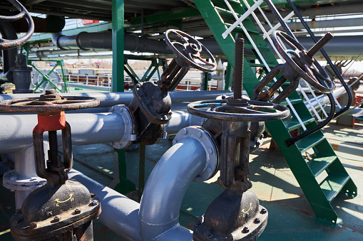 Gate valves and pipelines on the deck of an oil tanker