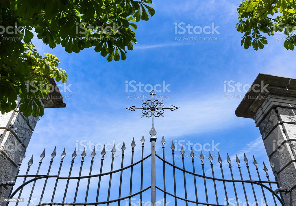 Gate with cross stock photo