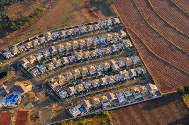 Gated community aerial view at sunrise. Gated community suburban aerial view at sunrise. gated community stock pictures, royalty-free photos & images