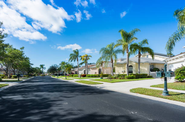 Gated community houses with palms, South Florida Typical gated community houses with palms, South Florida gated community stock pictures, royalty-free photos & images