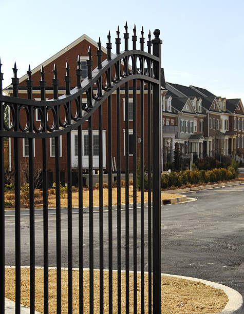 Gated  Community Luxury homes in a new gated community in the suburbs gated community stock pictures, royalty-free photos & images