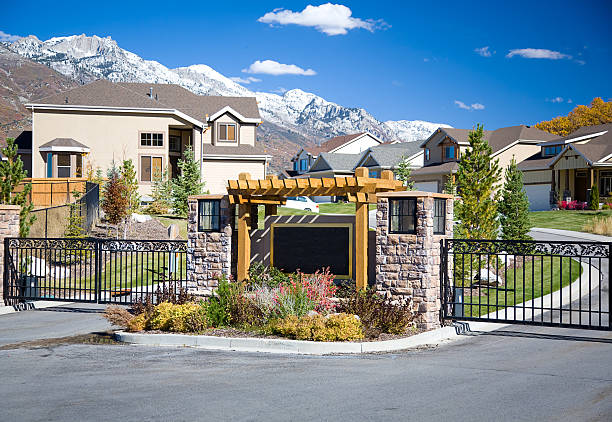 Gated Community The security gate outside a prestigious gated residential community. gated community stock pictures, royalty-free photos & images