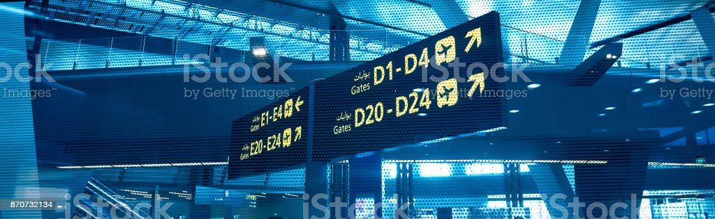 Gates D and E. Sign in airport. Interior of the airport. stock photo