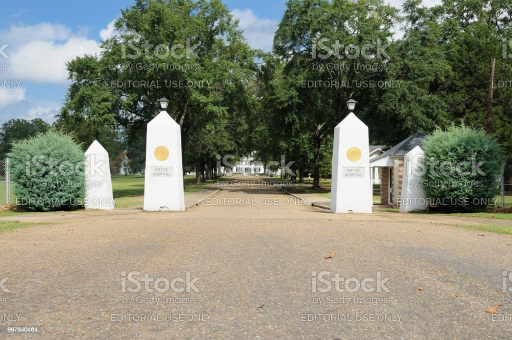 Gates leading to entrance of Bryce Hospital in Tuscaloosa stock photo