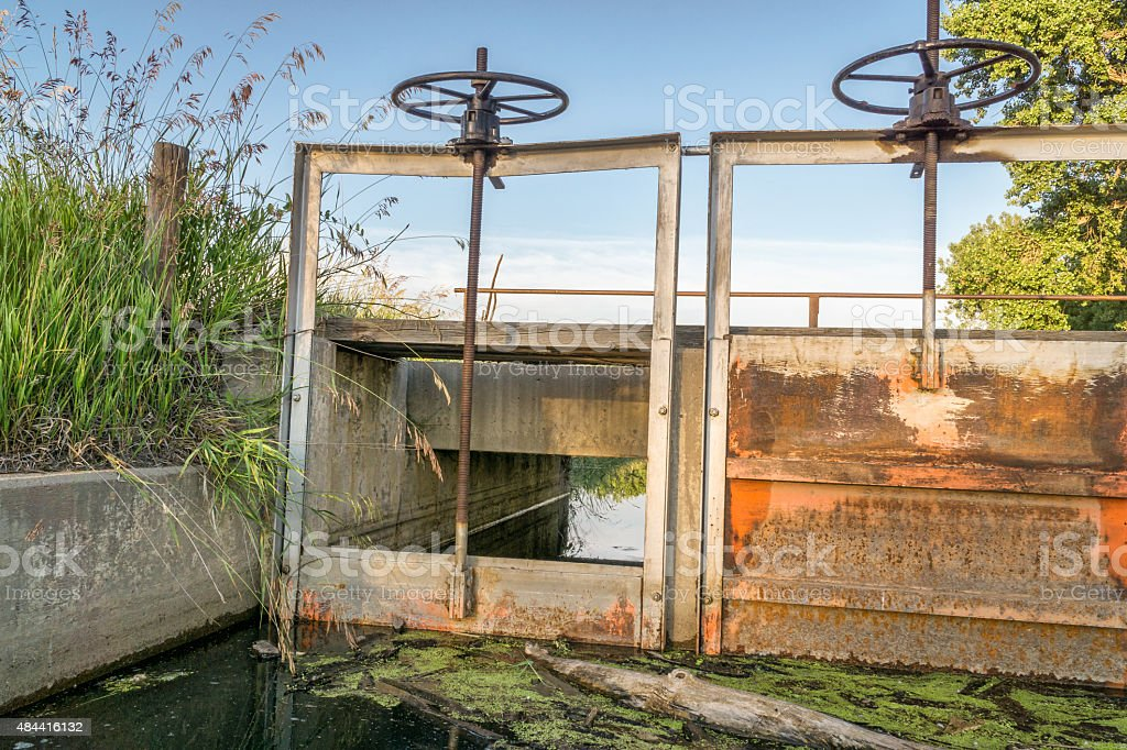 gates of irrigation channel stock photo