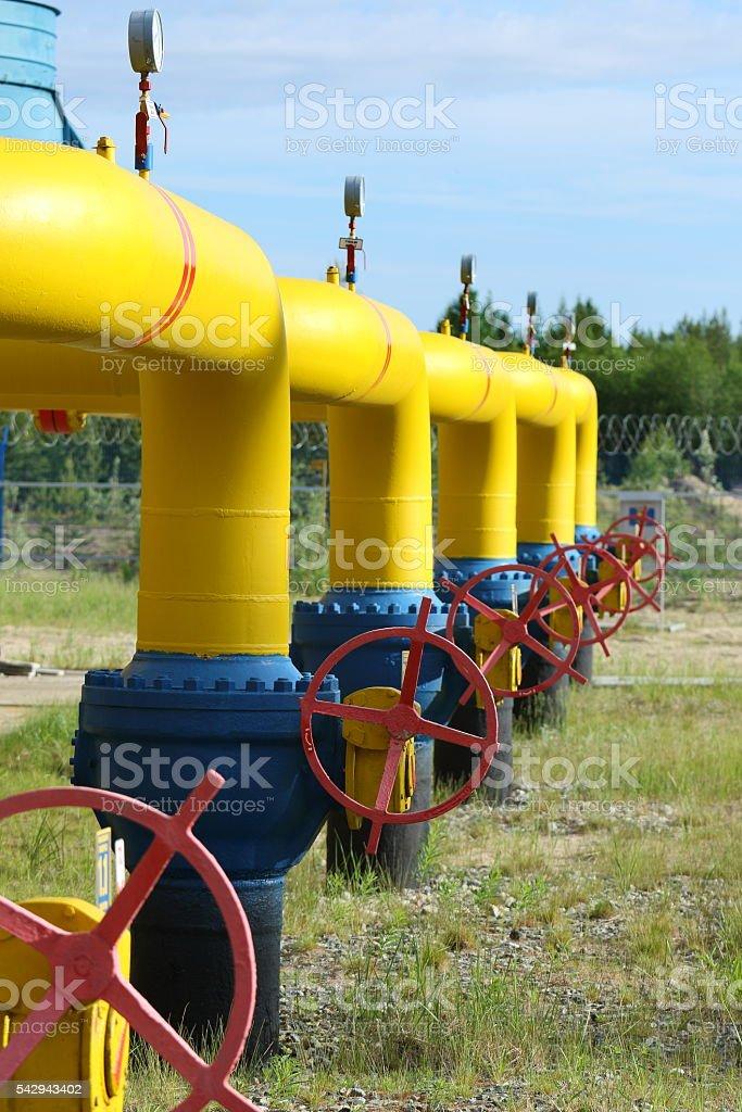 Gates on yellow gas pipes stock photo