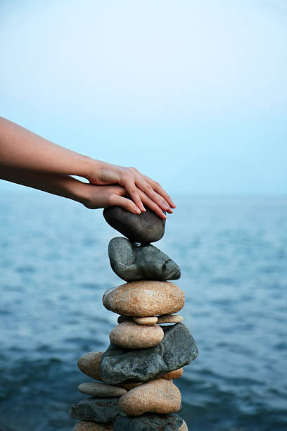 gather strength from nature - stack rock stock pictures, royalty-free photos & images