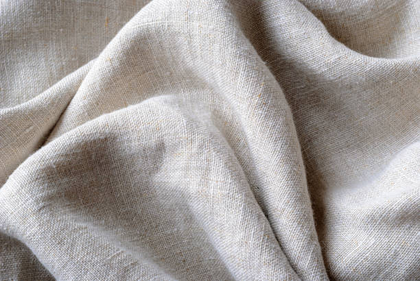 Gathered and folded texture of woven linen fabric stock photo