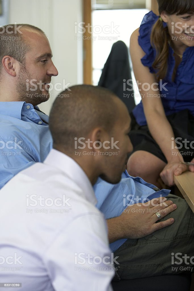 gathered around a desk royalty free stockfoto