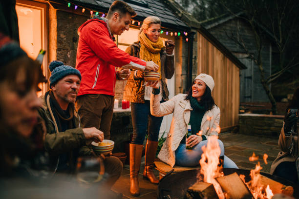 Gathered Around a Fire on a Winter Evening stock photo