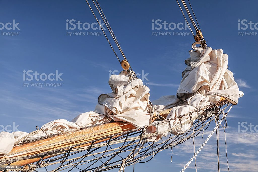 Gathered sail of a big sailing ship stock photo