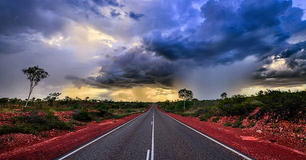 Gathering storm in Australia A HDR image of a gathering storm near a highway Down Under. outback stock pictures, royalty-free photos & images