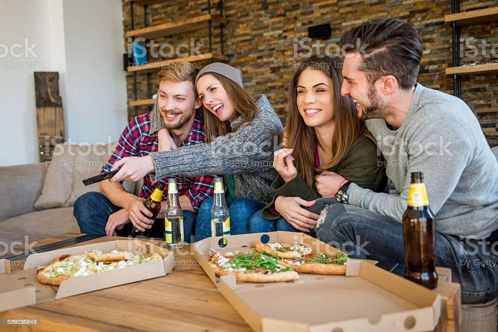 Gathering with beer and pizza royalty-free stock photo