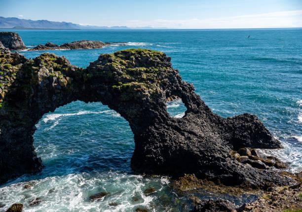 Gatklettur - Arch Rock - cliff with natural arch near Arnarstapi, Snaefellsnes, Iceland stock photo