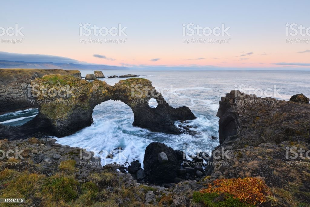 Gatklettur at autumn sunset, an  Arch Rock in west Iceland stock photo