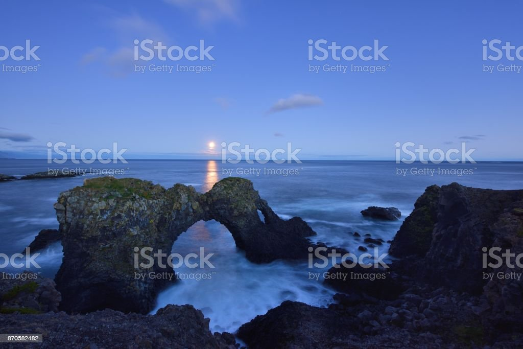 Gatklettur at autumn with Moonrise, an  Arch Rock in west Iceland stock photo