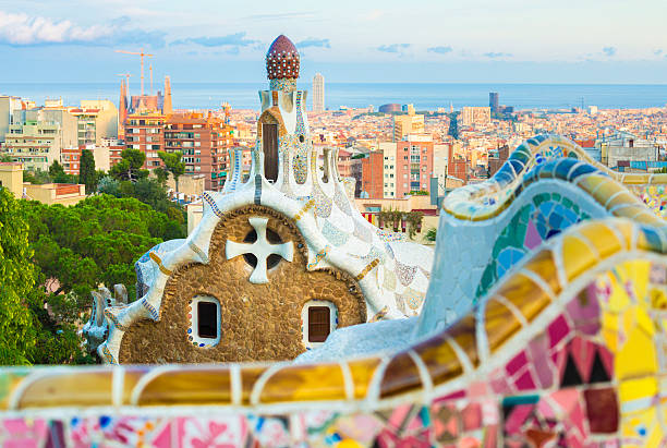 Gaudi's Park Guell in Barcelona Barcelona cityscape seen from Park Guell. gracia baur stock pictures, royalty-free photos & images