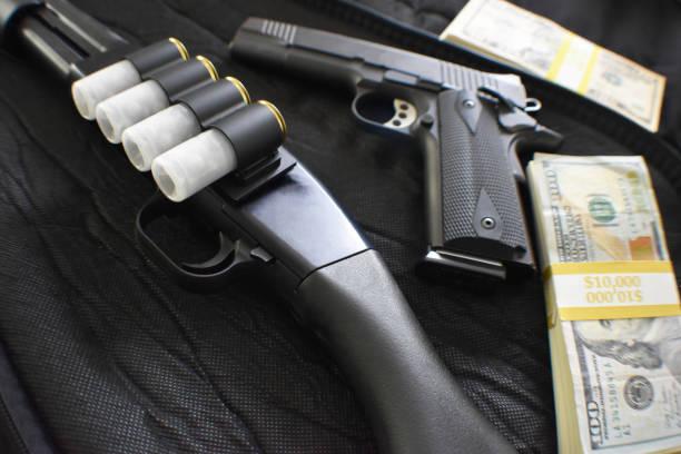 12 Gauge Shotgun With 45 Auto 1911 Handgun With American Money High Quality 12 Gauge Shotgun With 45 Auto 1911 Handgun With American Money drug cartel stock pictures, royalty-free photos & images