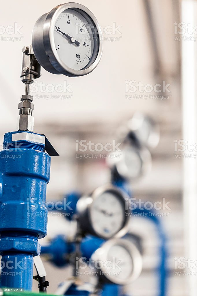 Gauges measuring pressure at factory stock photo