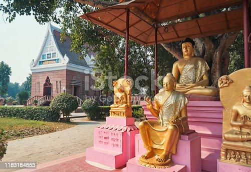 Wat Thai Temple & Monastery of Sarnath, Uttar Pradesh, India. Some buddhist religious slokas are written near the statue.
