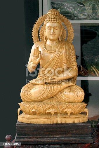 Gautam Buddha statue kept on display outside an artifact's shop.