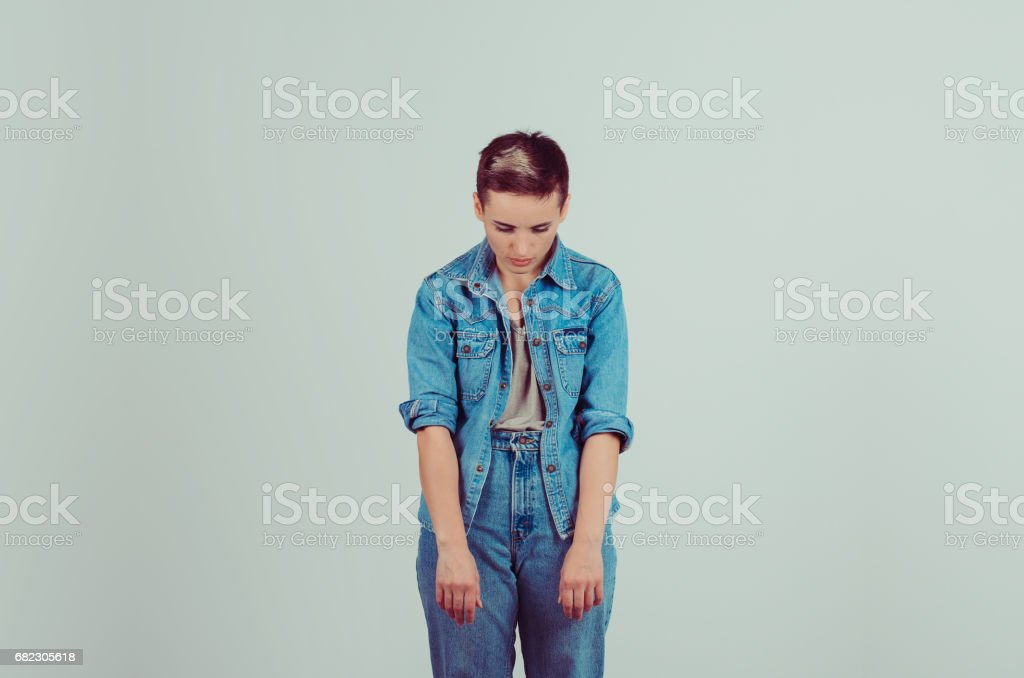 Gave up, defeated. Portrait half body sad insecure teenager hands head down isolated grey green background. Body language, Life perception stock photo
