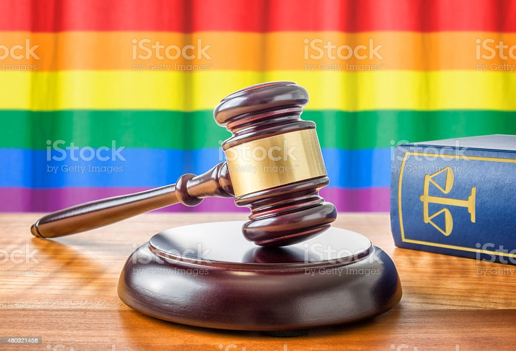 Gavel and a law book - Rainbow flag stock photo