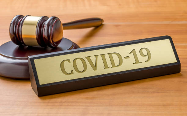 A gavel and a name plate with the engraving COVID-19 A gavel and a name plate with the engraving COVID-19 lawsuit stock pictures, royalty-free photos & images