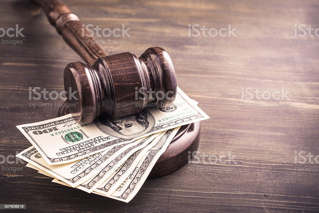 Gavel and dollars banknotes on table stock photo