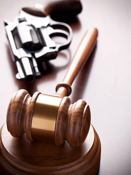 Gavel and Hand Gun stock photo