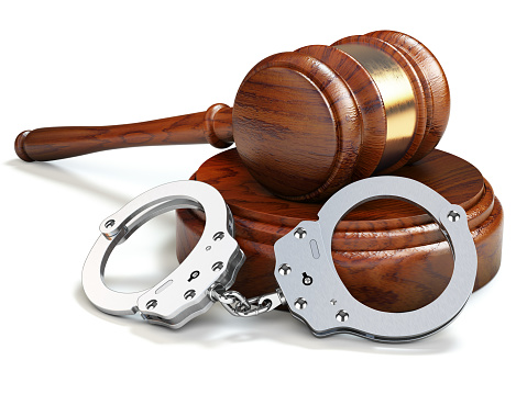 istock Gavel and handcuffs isolated oin white background. Law and justice concept. 963300338