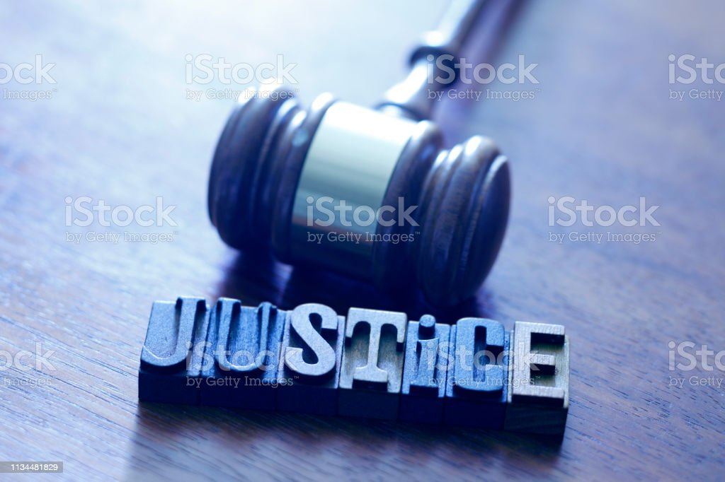 Gavel And Letters Spelling Out The Word Justice stock photo