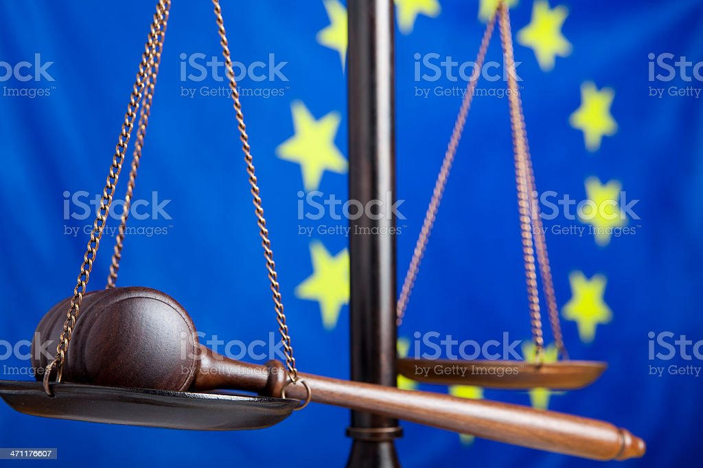 Gavel and scale against EU flag royalty-free stock photo