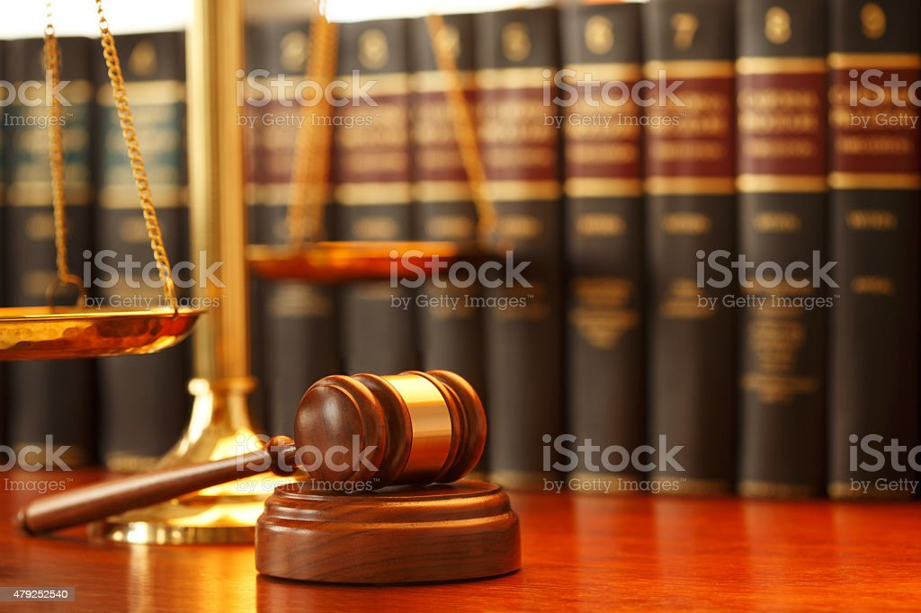 Gavel And Scales Of Justice On Desk In Law Office stock photo