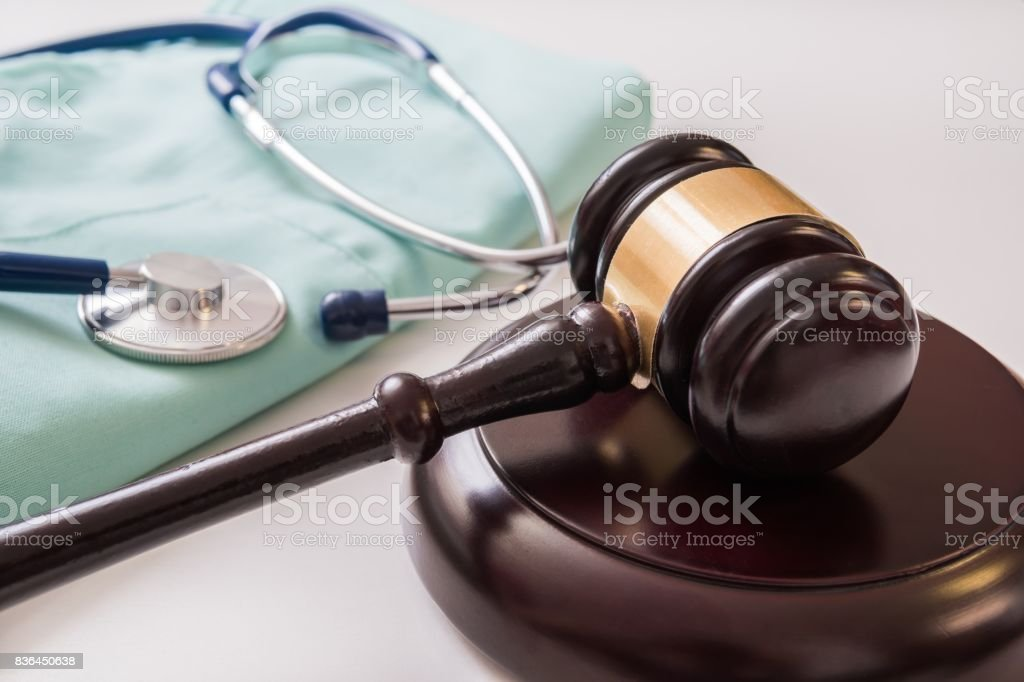 Gavel and stethoscope in background. Medical laws and legal concept. stock photo