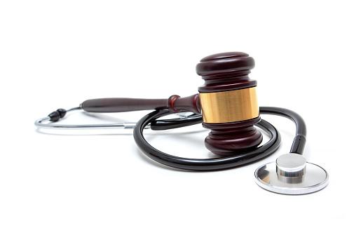 Gavel and stethoscope isolated on white background
