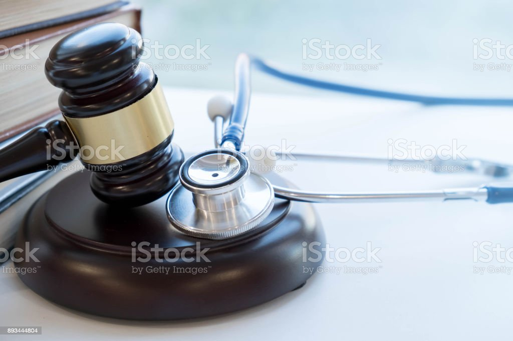 Gavel and stethoscope. medical jurisprudence. legal definition of medical malpractice. attorney. common errors doctors, nurses and hospitals make stock photo