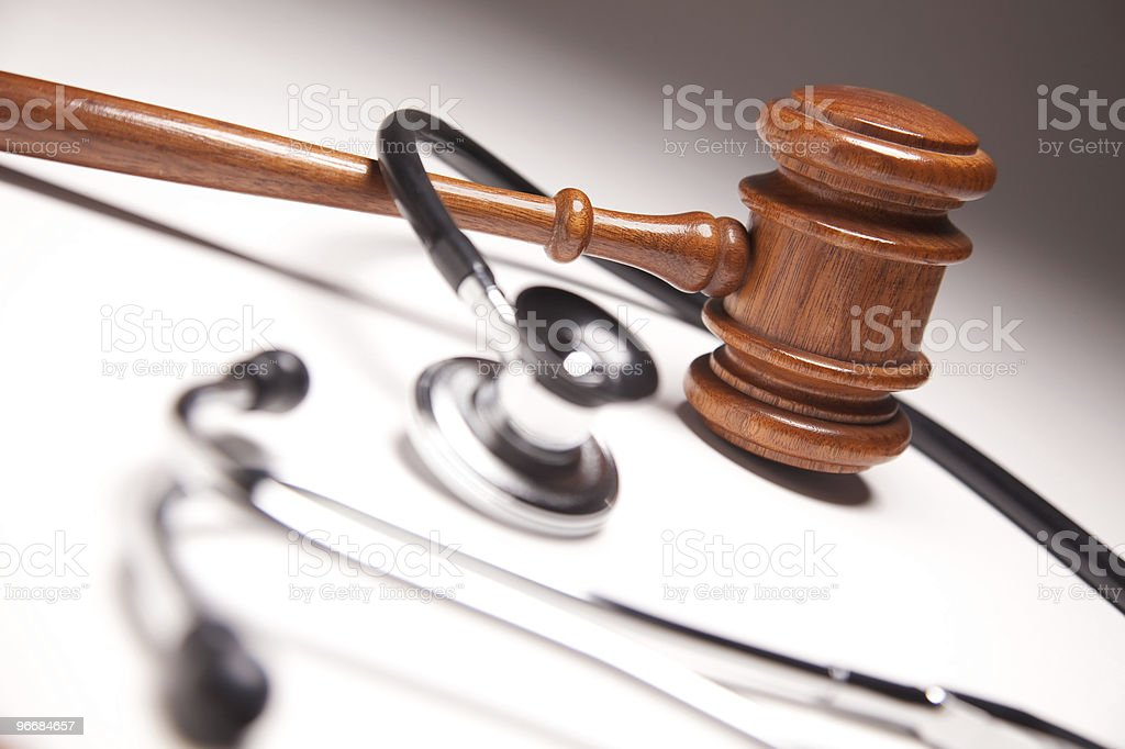 Gavel and Stethoscope on Gradated Background royalty-free stock photo
