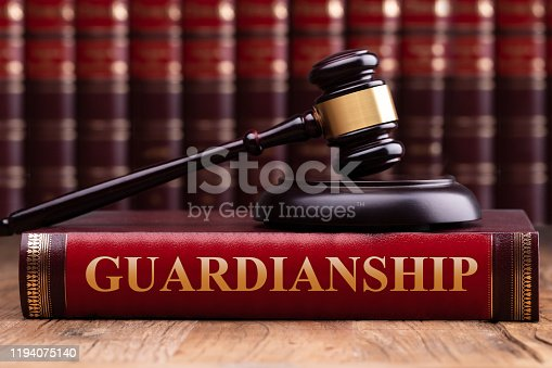 istock Gavel And Striking Block Over Guardianship Law Book 1194075140
