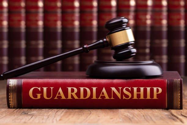 Gavel And Striking Block Over Guardianship Law Book stock photo