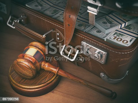 istock Gavel and suitacse full of money. Concept for corruption 697390256