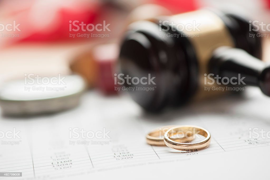 Gavel and wedding rings stock photo