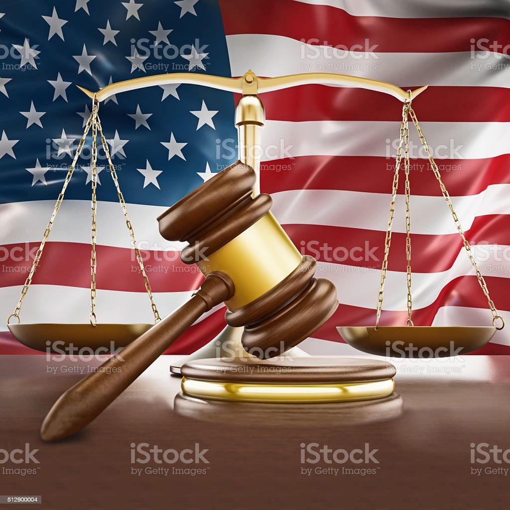 Gavel, gold balanced scale and American flag on the background stock photo