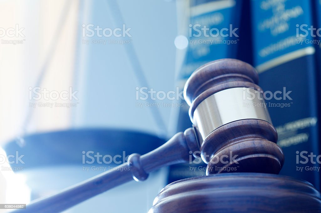 Gavel In Front Of Justice Scale And Law Books stock photo
